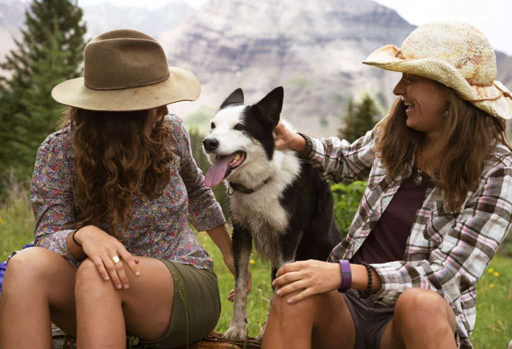 two women and dog on hiking trails in Colorado