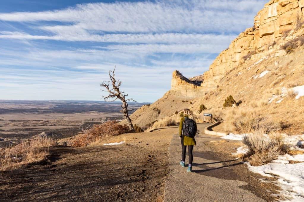 Woman walking in Mesa Verde National Park in the winter